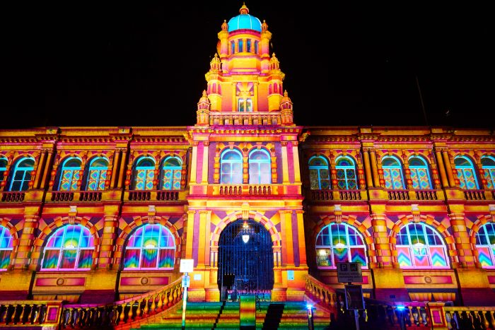 Durham's Old Shire Hall illuminated with warm shades of orange and yellow