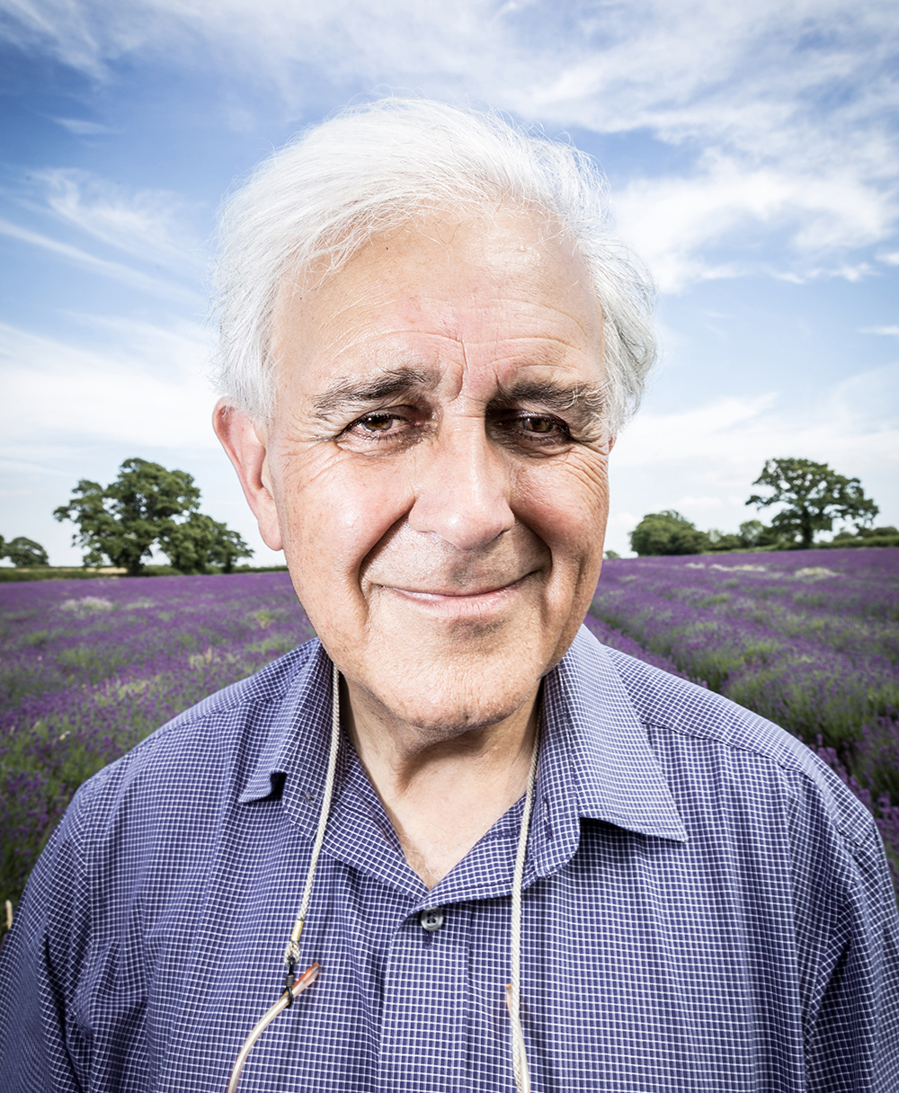 Close up image of man with field of Lavender as background.