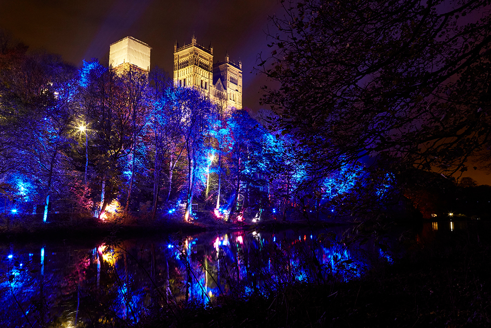 Large Scale purple projection on the trees below Durham Cathedral.