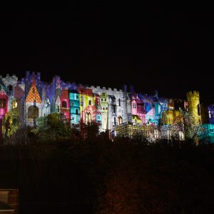 Colourful projection on FurhamCastle wall.