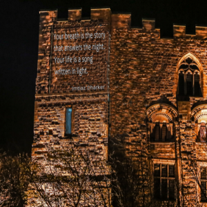 rendering of a poem projected onto the walls of Durham castle